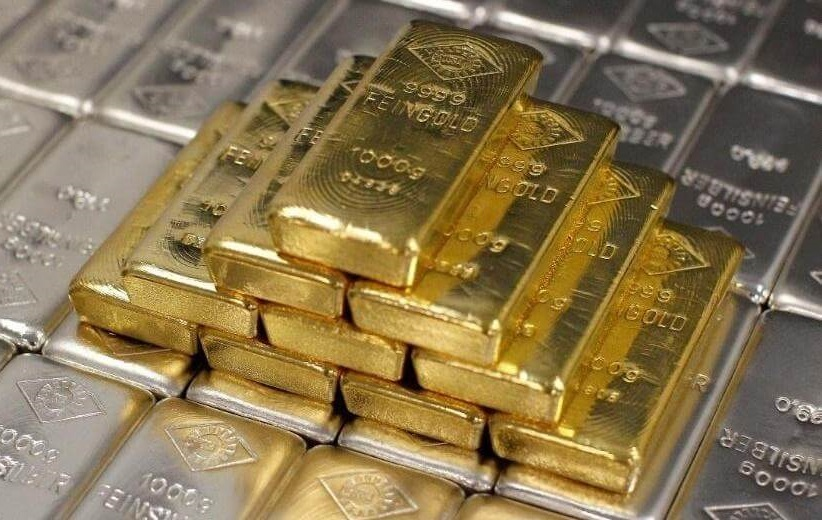 Stack of gold bars on silver bars