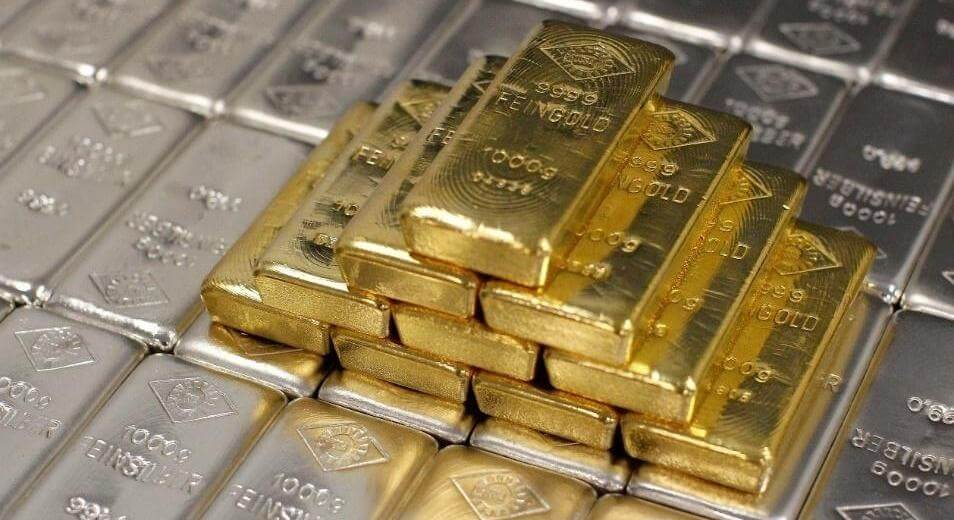 Stack of 1 kg gold bullion and 1 kg silver bullion bars